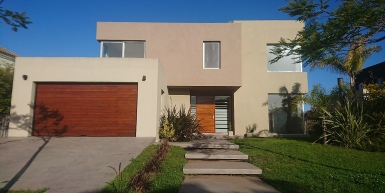 Modern house overlooking the golf course for sale and rental